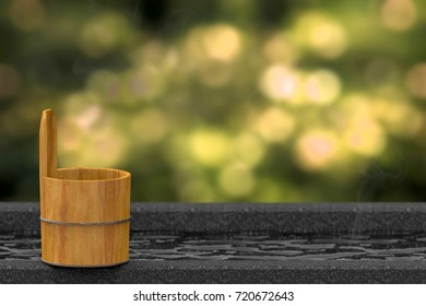 3D rendering. Japanese wood bath bowl on Hot spring bathtub or onsen with blurred green forest bokeh as background