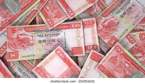 A 3D rendering of a macro close-up view of a messy scattered pile of malaysian hong kong dollar banknotes