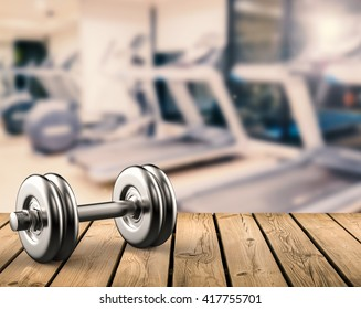 3d rendering metal dumbbell with gym background