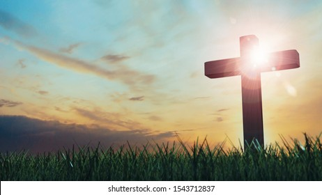 3D Rendering of old wooden cross on grass hill with dramatic ray lights from sky. Concept of Jesus Christ cross, Easter, resurrection, crucifixion, Ascension day