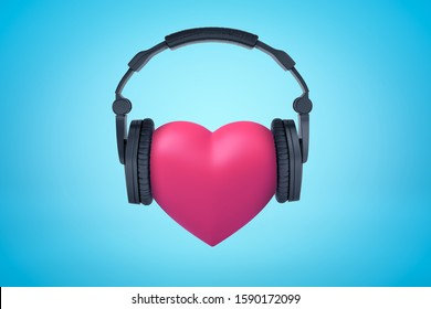 3d rendering of pink heart with black headphones on blue background. Digital art. Feelings and emotions. Music and sound.