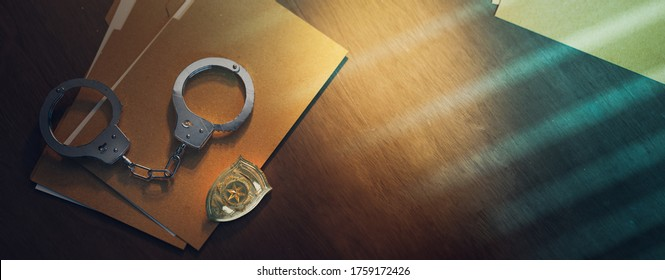 3D rendering of a police badge with handcuffs on a dark background