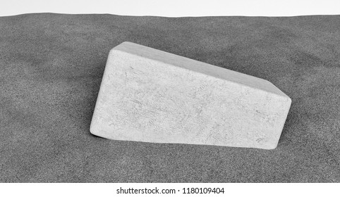 3D rendering of rectangular stone cube half buried in the sand. Black and white image