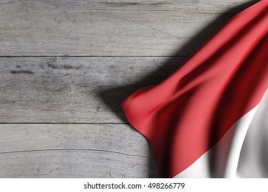 3d rendering of Republic of Indonesia flag waving on wooden background