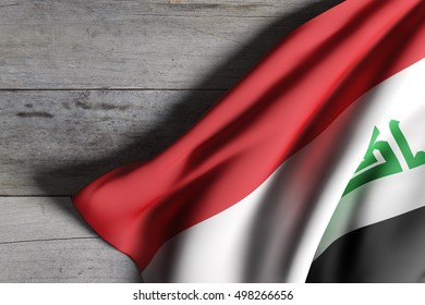 3d rendering of Republic of Iraq flag waving on wooden background
