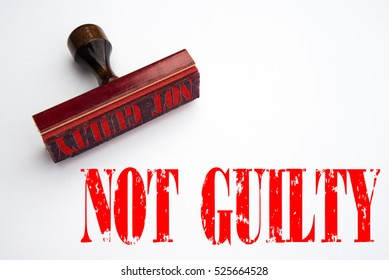 """A 3d rendering of a rubber stamp with the words """"not guilty"""""""
