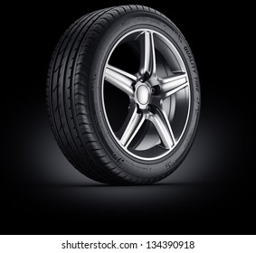 3d rendering of a single car tire on a black background