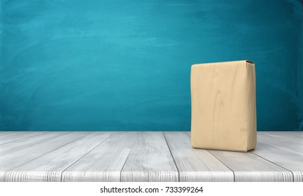 3d rendering of a single closed cement bag vertically placd on a wooden desk on blue background. Best cement grade. Good quality building supplies. Cement powder bag.