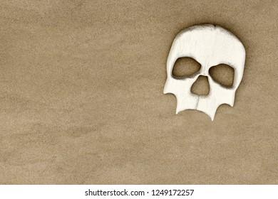 3d rendering of skull on sand