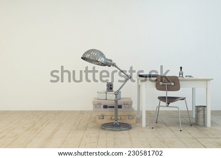 3D Rendering of Small simple work area with a table and chair , a standard lamp and vintage suitcases on the floor in a white painted room with wooden floor and copyspace in a modern interior design