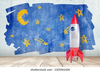 3d rendering of a toy space rocket standing at the wall with a children's drawing of a starry sky. Organise children's leisure. Imagine and create. Aim for stars.
