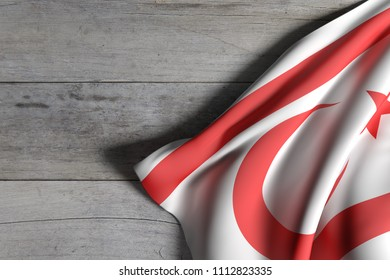 3d rendering of Turkish Republic of Northern Cyprus flag over a wooden surface