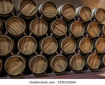 3d rendering of vine cellar with oak barrels stacked in rows