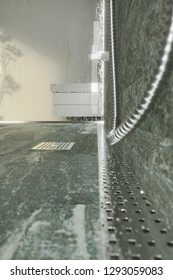 3d rendering of water drops on metal gutter at shower tray with quartzite stone tiles in the evening sunshine