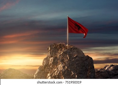 3d rendering of waving albanian flag on rocky landscape to celebrate the national holiday of 28 november
