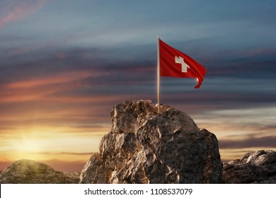 3d rendering of waving Swiss flag on rocky landscape to celebrate the national holiday of 1 august