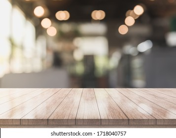 3D Rendering, Wooden top table with bokeh light effect and blur restaurant on background, blur background