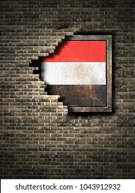 3d rendering of a Yemen flag over a rusty metallic plate embedded on an old brick wall