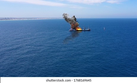 3D rendering-Cargo ship burning on fire with large scale smoke-Aerial Aerial, Mediterranean Sea, Cargo tanker ship, Real Drone view with visual effect Elements