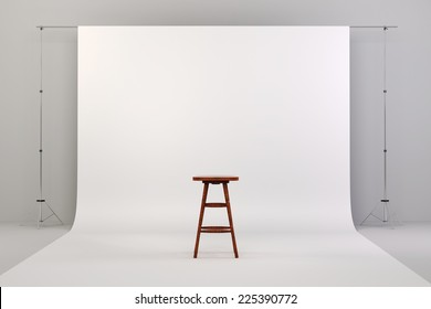 3d studio setup with white background and wooden chair