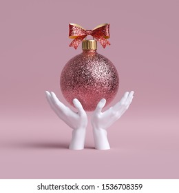 3d white mannequin hands holding rose gold Christmas tree ball ornament decorated with bow, isolated on pink background. Holiday fashion concept. Festive clip art.