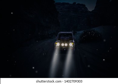 4x4 car in the desert with lights on in the night and flying fireflies. Travel and adventure concept.