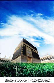 A4 template islamic background , showing the holy kabaa masjid on a green field and blue sky.