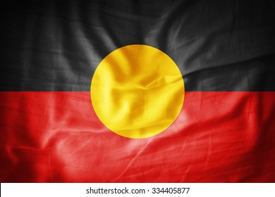 Aboriginal Australia flag on grunge fabric
