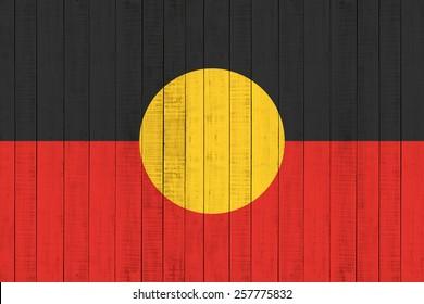 Aboriginal Australia flag Flag on wood background