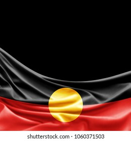 Aboriginal Australia flag of silk with copyspace for your text or images and black background -3D illustration