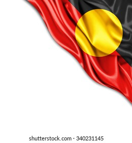 Aboriginal Australia flag of silk with copyspace for your text or images and white background