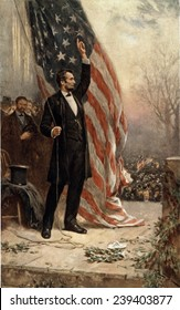 Abraham Lincoln (1809-1856) in published on the 100th anniversary of his birth in 1908. Scene alludes to the speakers' platform at Gettysburg and General Grant stands in the background