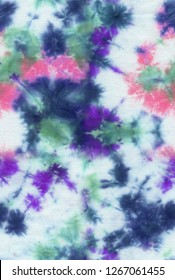 Absctract seamless tie-dye hand painted fabriс background with irregular floral spots