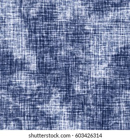 Abstract acid-washed stains on subtle checked textured background. Seamless pattern.