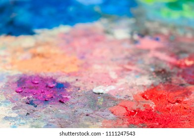 Abstract background of vibrant colors on a palette. / Various colors on a palette