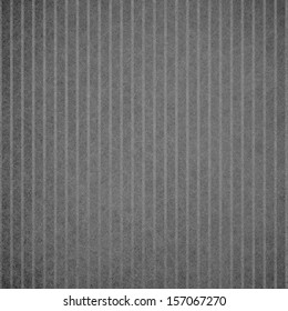 abstract black background or gray design pattern of vertical lines on faint vintage pattern of vintage grunge background texture on black border or monochrome card brochure or web template background