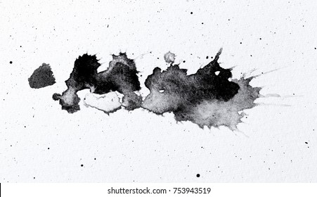 abstract black splashes on white watercolor paper. monochrome image