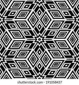 An abstract black and white pattern in the style of artist MC Escher.