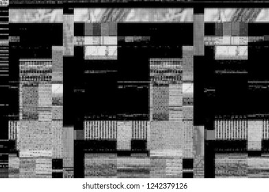 Abstract black and white pixel pattern background of a digital glitch. / Pixel pattern of a digital glitch