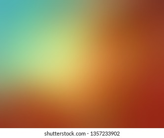 abstract blue green and warm burnt copper orange blurred background colors in soft blended design with yellow sunspot or spotlight