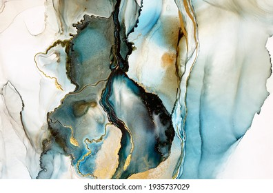 Abstract blue-green background with gold and beautiful smudges made with alcohol ink and golden acrylic. Fragment of art with turquoise texture resembles watercolor or aquarelle painting.