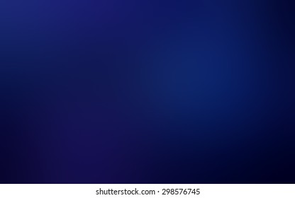 Abstract blurred background with magic blue light on dark background