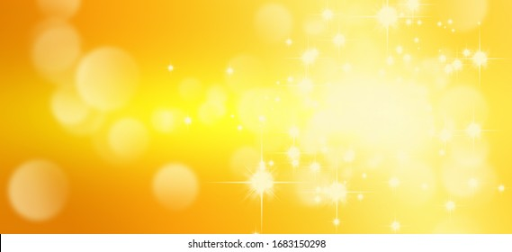 Abstract blurry image of light and golden bokeh background.