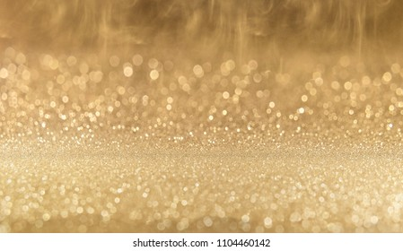 Abstract of Bright and sparkling bokeh background. gold and diamond dust bokeh - blurred lighting from glitter texture. Luxury design background.