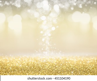 Abstract of Bright and sparkling bokeh background. golden bokeh -blurred lighting from glitter texture. Luxury design background.