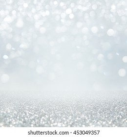 Abstract of Bright and sparkling bokeh background. silver and diamond dust bokeh -blurred lighting from glitter texture. Luxury design background.