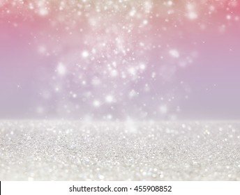 Abstract of Bright and sparkling bokeh background. silver bokeh -blurred lighting from glitter texture. Luxury design background.