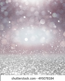 Abstract of Bright and sparkling bokeh background. Silver bokeh-blurred lighting from glitter texture. vintage style background.