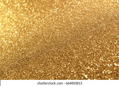 Abstract of Bright and sparkling bokeh background. Golden and diamond dust bokeh -blurred lighting from glitter texture. Luxury design background.