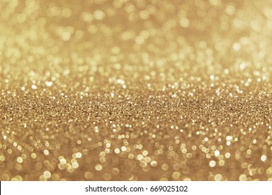 Abstract of Bright and sparkling bokeh background. golden and diamond dust bokeh -blurred lighting from glitter texture. Blue color Luxury design background.